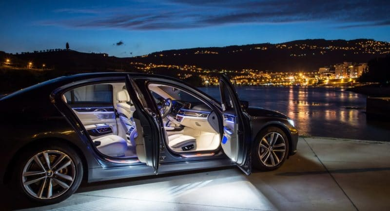 Luxury car stunning image of fully light interior against city skyline at dusk